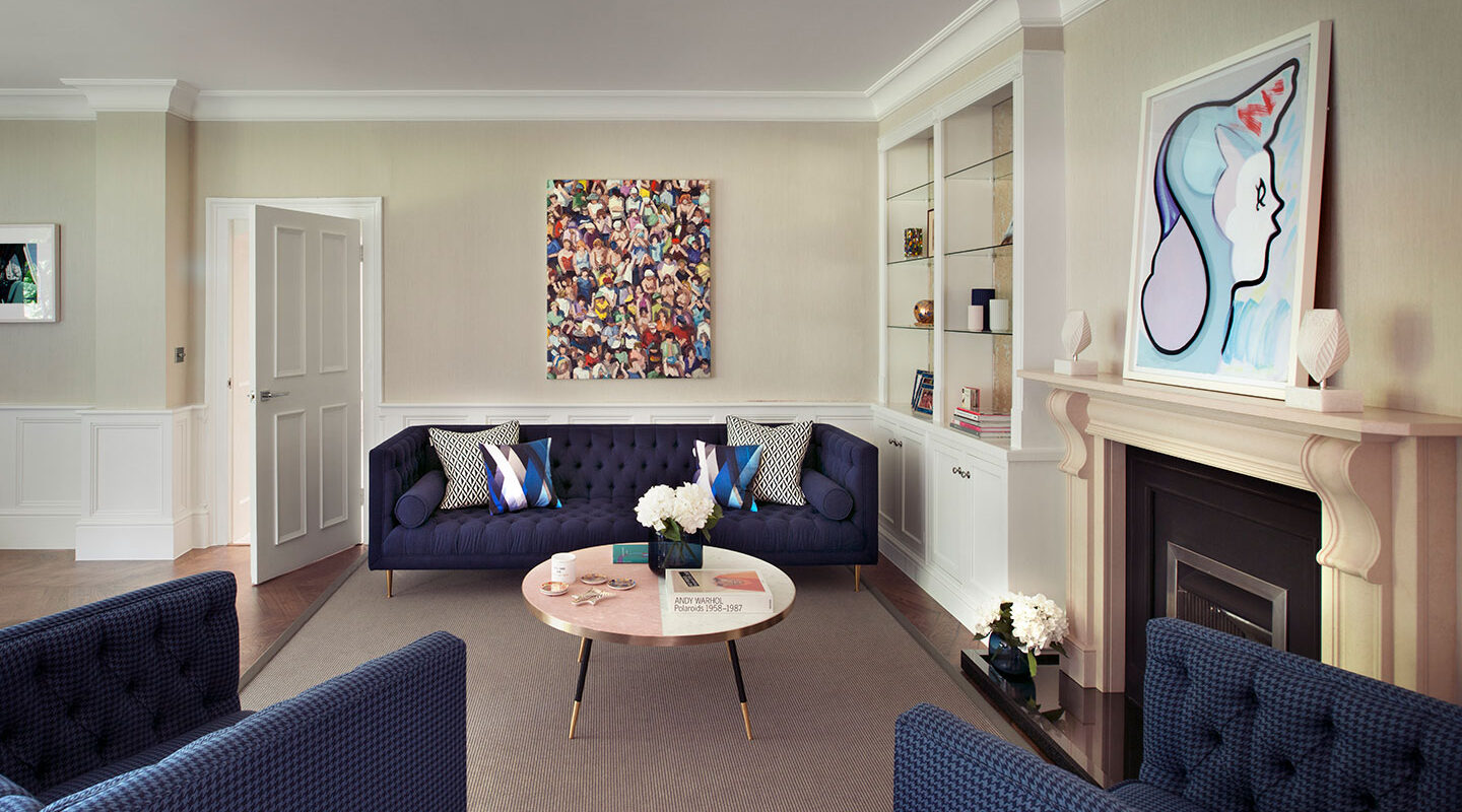 Curated art hangs on the wall of a luxury interior designed living room