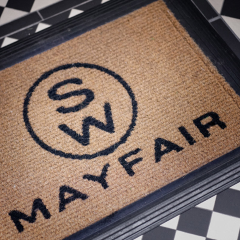 A custom Mayfair doormat leads the way to a luxury designed interior, London