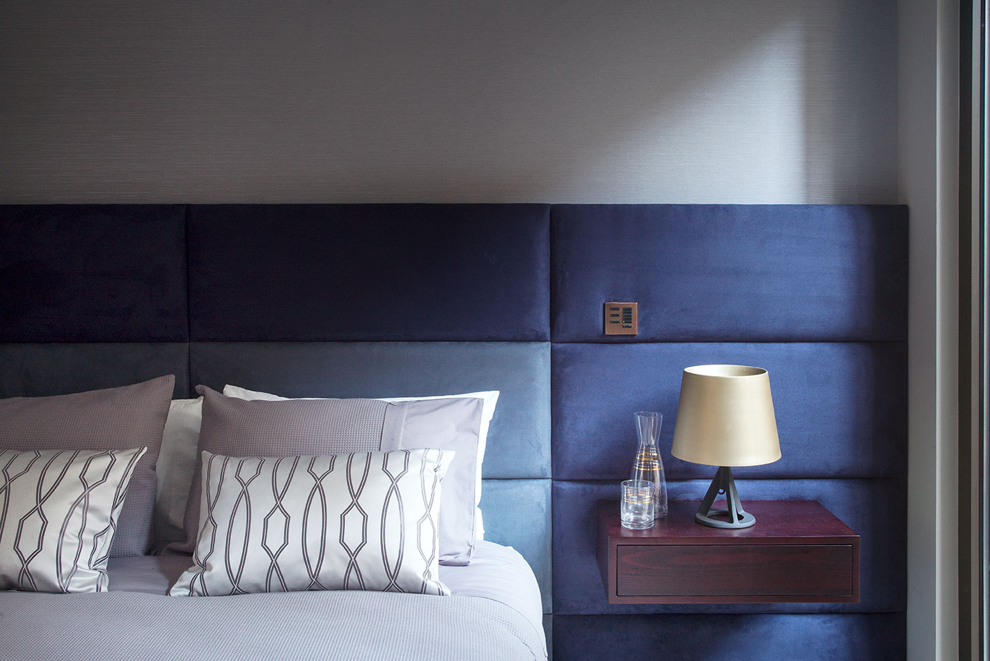 Blue headboard and lamp in a luxury designed interior bedroom