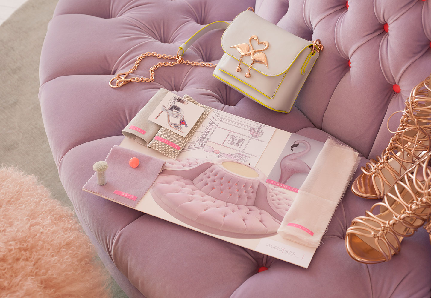 A Sophia Webster handbag and show sit next to the interior design sketches for the showroom