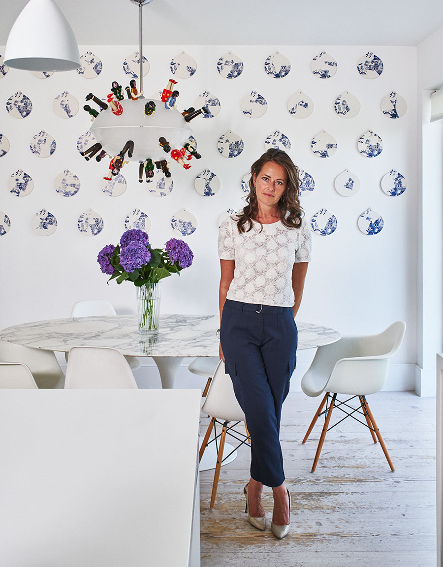 Simone Suss, founder of Studio Suss stands in a uniquely designed sitting room interior