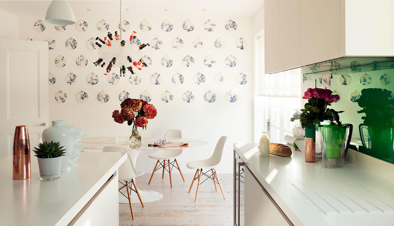 A kitchen with unique wallpaper in a designed interior