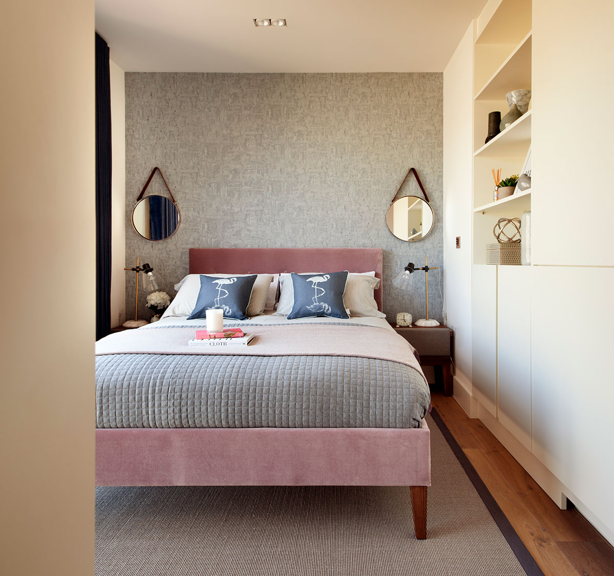 A comfortably designed bedroom in a cosy interior