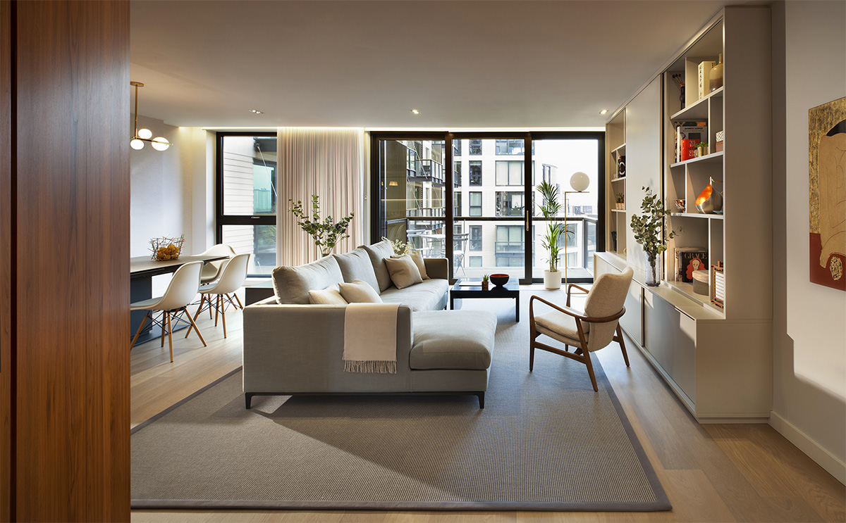 Residential interior design in Kings Cross with living room lit by large windows on stylish colours