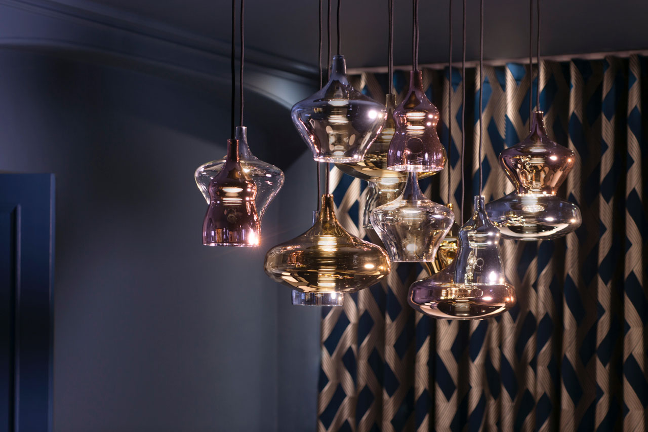 Unique blown glass lights hand above a moody, luxury designed room for a house in North London