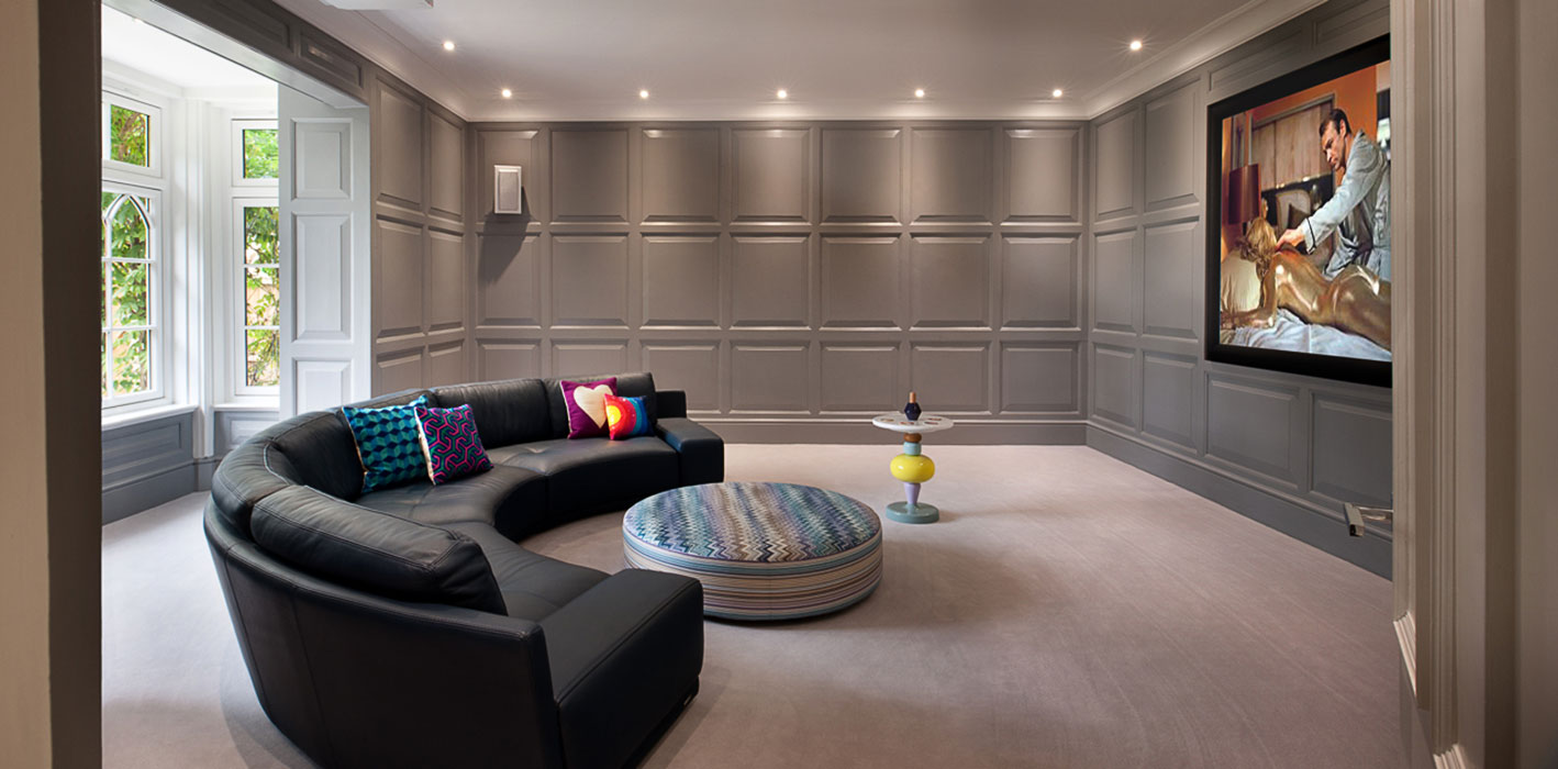 Spacious cinema room with wood panelling in a luxury interior design based in a North London family home