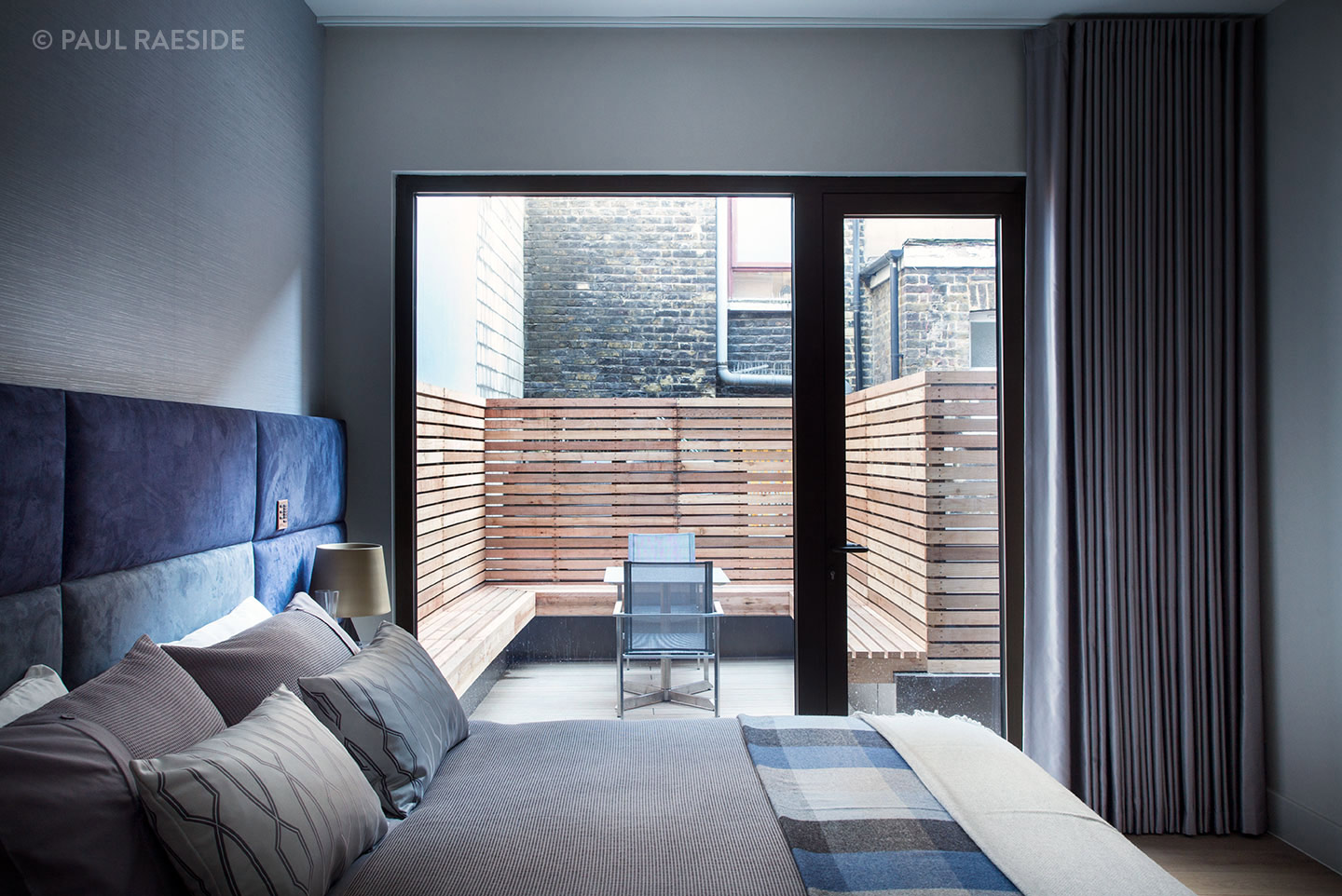 French doors open to a terrace in a luxury interior designed Soho flat, London