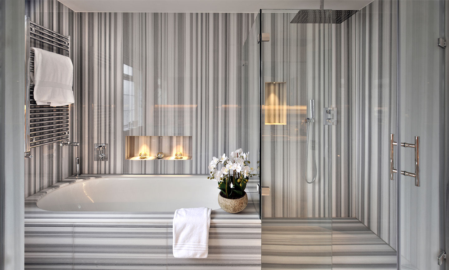Beautifully lit bath in a beautifully designed interior