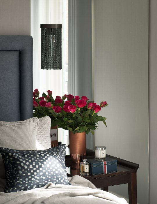 St Johns based Interior Design by Studio Suss in London. Red roses sit on a bedside table.