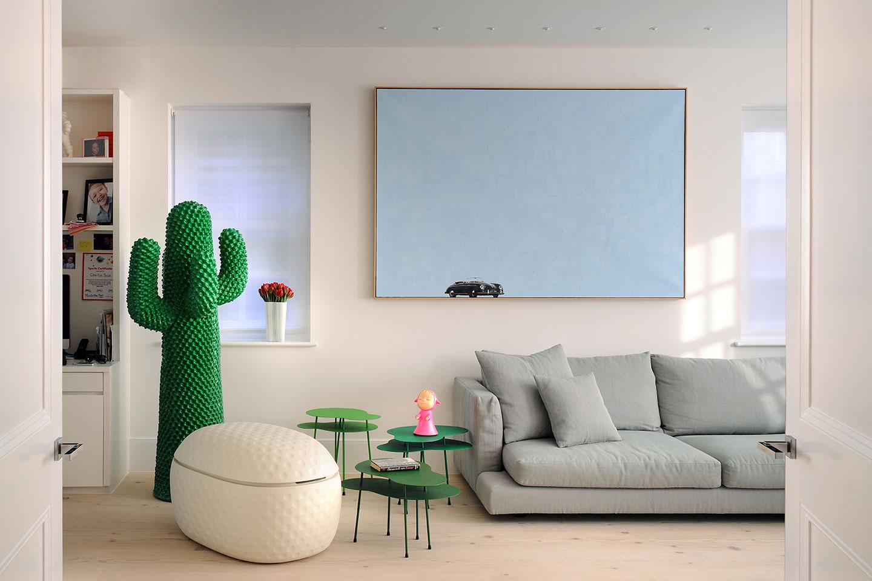Cactus cushion sits in a luxury designed interior.