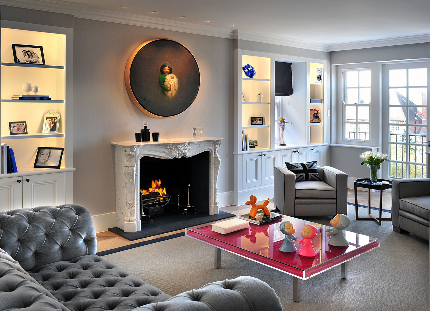 A fireplace adorns the sitting room of a luxury interior design, Hampstead