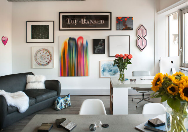 Curated art hands inside the naturally lit Studio Suss interior design office, Kings Cross, London